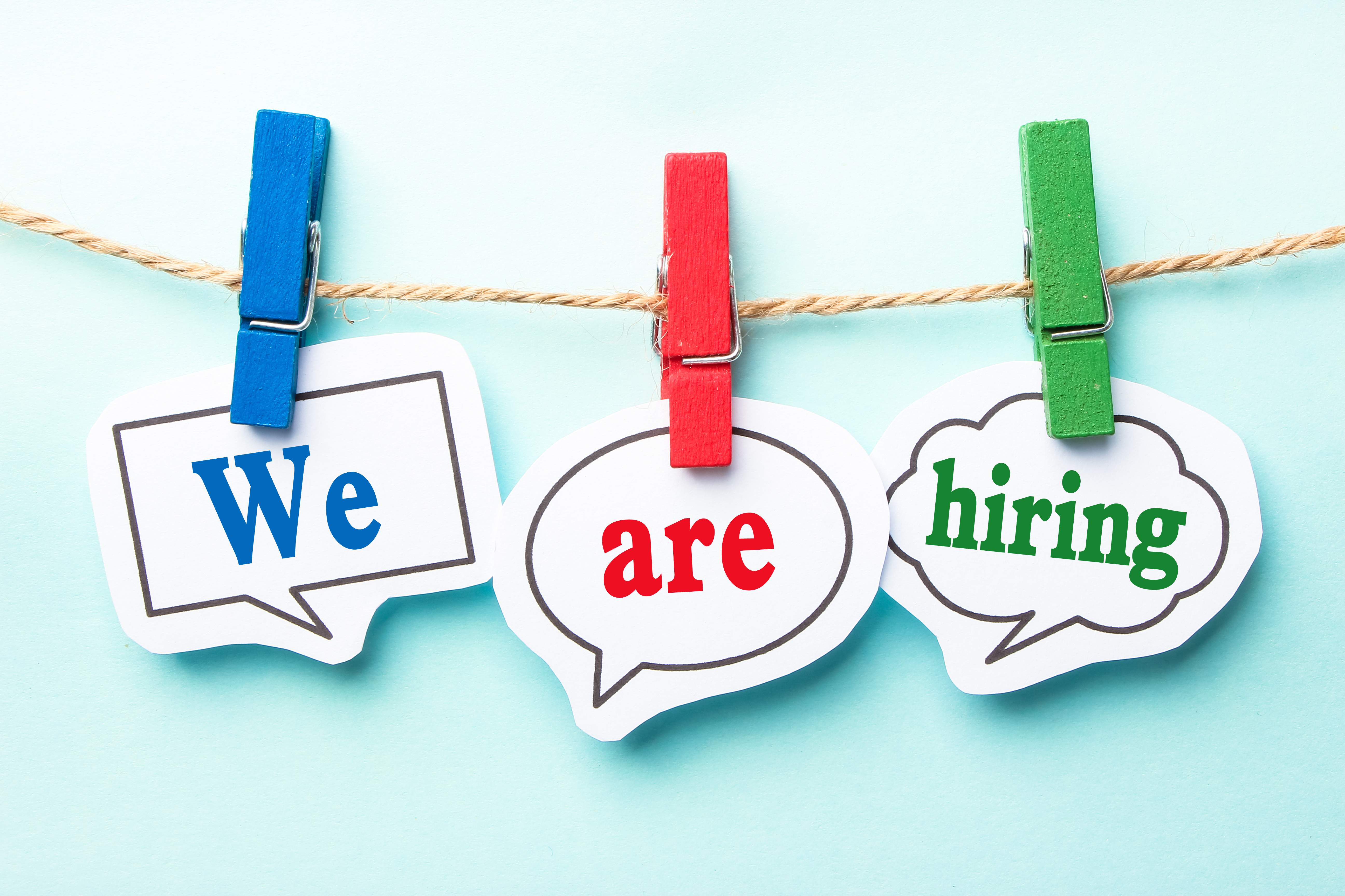 We are hiring concept paper speech bubbles with line on the light blue background.